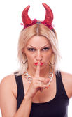 Blonde with horns making a hush gesture — Stock Photo