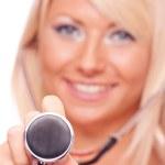 Blonde holding stethoscope — Stock Photo #28829283