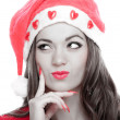 Young woman with Santa hat thinking — Stock Photo