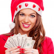 Female Santa with cash — Stock Photo #31875401