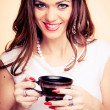 Young woman holding coffee — Stock Photo