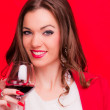 Young brunette with red wine — Stock Photo