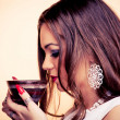 Young woman drinking coffee — Stock Photo #31875441