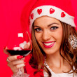 Young woman with Santa hat and red wine — Stock Photo