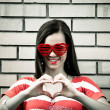Young woman make heart with fingers — Stock Photo #31875477