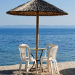 Chairs and table on the beach — Stock Photo