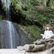 Stok fotoğraf: Little girl meditate by waterfall