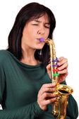 Saxofone de jogo de menina — Foto Stock