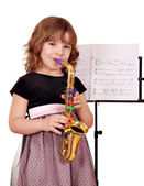 Little girl with saxophone — Stock Photo