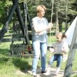 Mother and daughter on swing — Stock Video