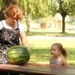 Mother and daughter with watermelon — Stock Video #12740637