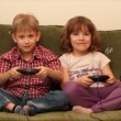 Boy and little girl play video game — Stock Video #12743834