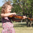 Stock Video: Little girl play violin