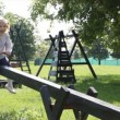 Young girl fun on seesaw — Stock Video