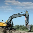 Stock Photo: Excavator working on road construction