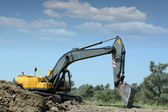 Excavator working on road construction — Foto Stock