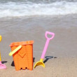 Child's bucket and spade on beach — Stockvideo