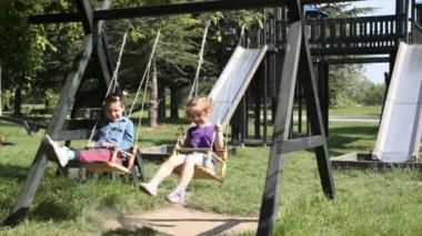 Children fun on swing — Stock Video
