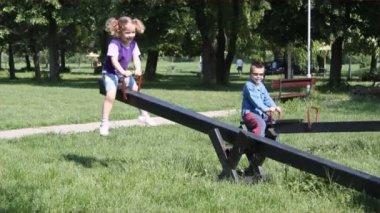 Children fun on seesaw — Stock Video