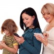 Little girl teenage girl and woman playing with smart phone and tablet — ストック写真