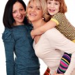 Happy mother and daughters — Stockfoto