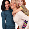 Happy mother and daughters — Stock Photo