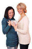 Happy mother and daughter with tablet — Stock Photo