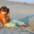 Little girl playing in sand — Stock Photo #13639935