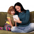 Teenage and little girl playing with tablet pc — Stock Photo #13639973