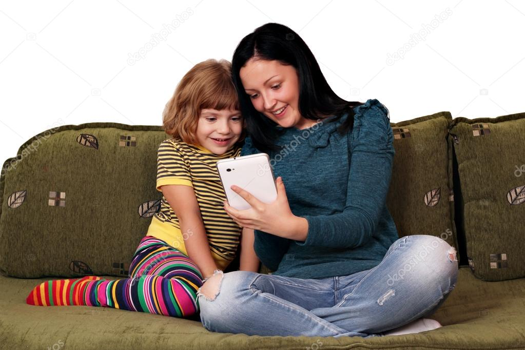 Teenage and little girl playing with tablet pc — Photo #13639973