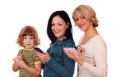 Kleine mädchen-teenager-mädchen und frau mit handys und tabletpc — Stockfoto
