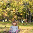 Happy little girl fun with autumn leaves — Stock Photo