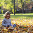 Royalty-Free Stock Photo: Happy little girl in autumn park