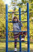 Happy little girl fun on playground — Stock Photo