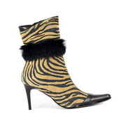 Women boot with tiger stripes on white — Стоковое фото