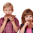 Boy and little girl eating chocolate — Stock Photo