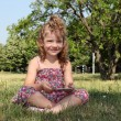 Little girl with tablet pc in park — Stok fotoğraf