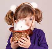 Little girl with white rabbit pet — Stock Photo