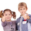 Happy little girl and boy with thumb up - Stock Photo