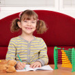 Stock Photo: Happy little girl school homework
