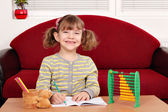 Happy little girl school homework — Stock Photo