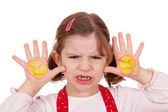 Angry little girl with angry smiley on hands — Stock Photo