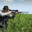 Hunter aiming with sniper rifle — Stock Photo #19214049