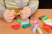 Child play with plasticine — Stock Photo