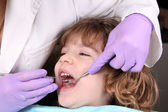 Child patient at the dentist dental examine — Stock Photo