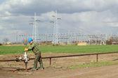 Oil worker open pipeline valve industry zone — Stock Photo