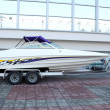 Fast boat on trailer ready for transport - Stock Photo