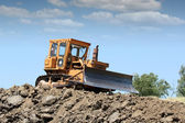 Bulldozer working on road construction — Stock Photo