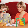 Mom helps daughter to solve homework — Stock Photo