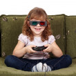 Happy little girl with 3d glasses play video game — Stock Photo #20804989
